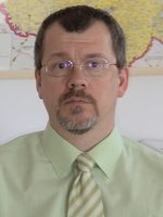 Dr. Mangel László